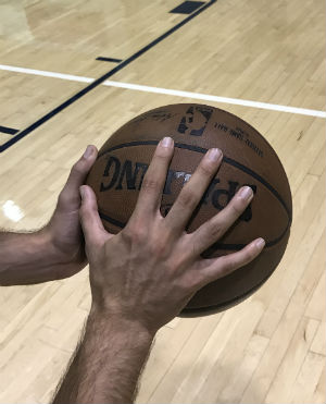 Learn to spin a basketball on your finger