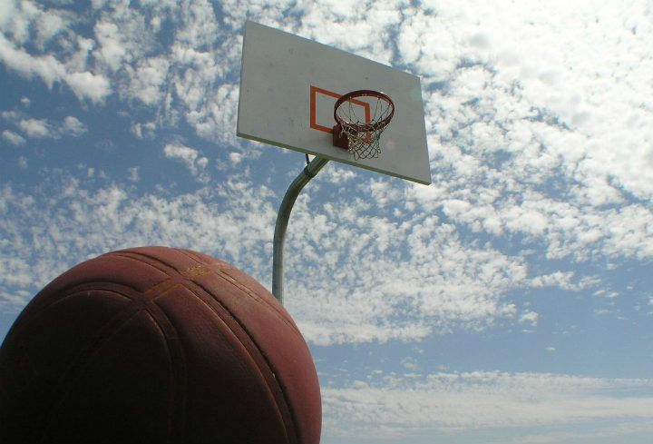 basketball on free outdoor court under cloudy sky