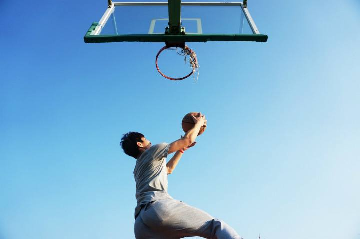 basketball player shooting under basket outdoor