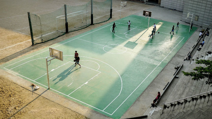 boys playing on outdoor basketball court