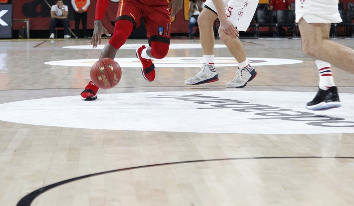 player dribbling basketball during game