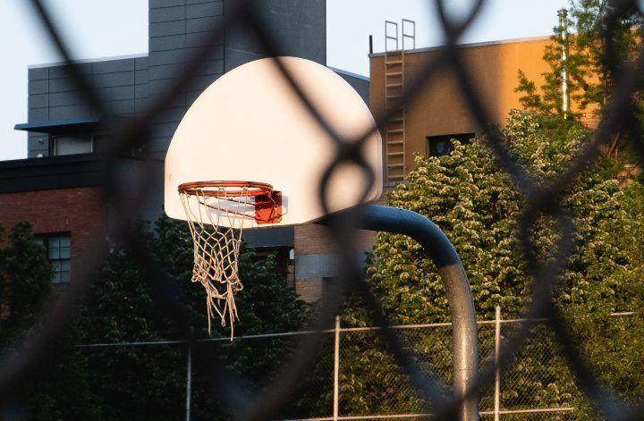 outdoor basketball hoop through fence