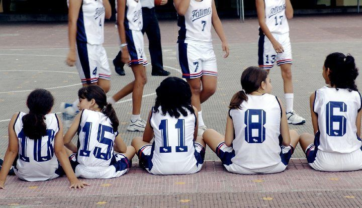 young girls waiting to play basketball